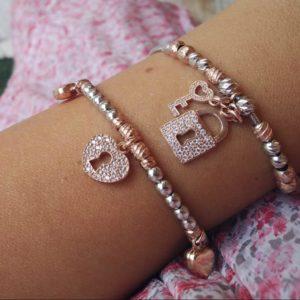 Bracciale in argento e oro rosa con lucchetto dell'amore Bracciale in argento e oro rosa con lucchetto dell'amore 68701923 2475509626011500 5241811583935447040 o 300x300